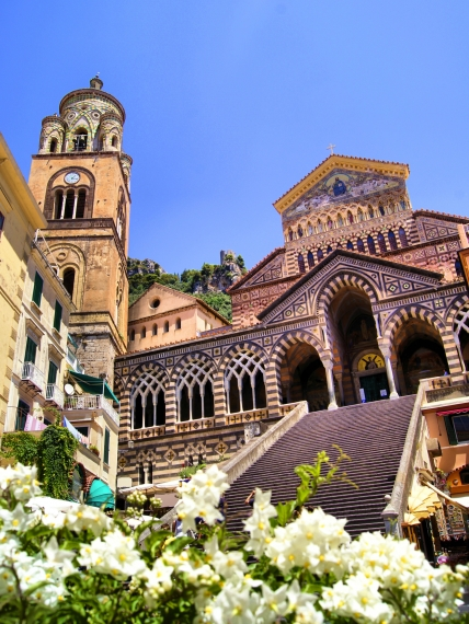 Ornate Amalfi Cathedral with flowers, Italy